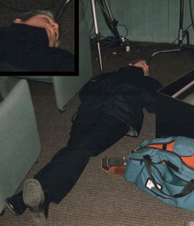 Rinder showcases his productivity yet again. In this instance, he is supposed to rehearse a speech for an annual international convocation. He has previously managed to sleep while the speech was written, but now he must prove himself capable of snoozing on the floor of the rehearsal studio. After all, why be well prepared when you can be super rested!